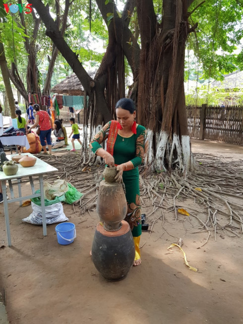 Artisan Dao Thi Tuyet Hang demonstrates pottery making at Vietnam Museum of Ethnology in Hanoi.