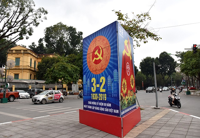 Panels and banners celebrating the Party's anniversary throughout the streets in downtown Hanoi.