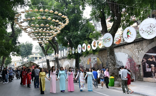 Vietnamese women in traditional long dress.