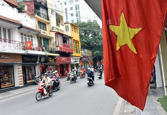 The national flag fluttering on Hang Gai street.