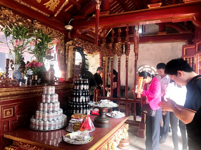Offering incense to the nation's founders at Hung Kings Temple.