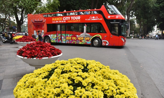The double-decker buses are more crowded than on normal days, bringing visitors to Hanoi's top destinations.