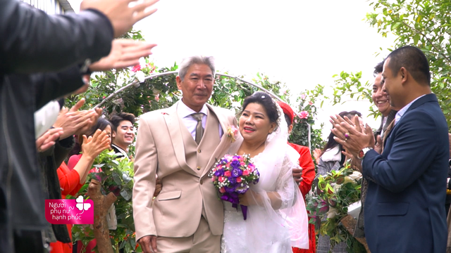 Peoples Artist Thanh Hoa is wearing her first wedding dress