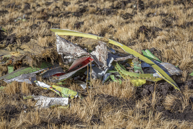 Parts of the plane wreckage at Bishoftu, or Debre Zeit, outside Addis Ababa, Ethiopia, Monday, March 11, 2019, where Ethiopia Airlines Flight 302 crashed Sunday. Investigators are trying to determine the cause of a deadly crash Sunday involving a new aircraft model touted for its environmentally friendly engine that is used by many airlines worldwide. (AP Photo/Mulugeta Ayene)