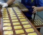 Giá vàng giảm nhẹ, giá USD ổn định