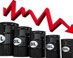 Giá dầu mỏ thế giới giảm sau khi FED giữ nguyên lãi suất