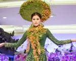 """Quán quân Vietnam""""s Next Top Model 2015 duyên dáng với áo dài kết hoa"""