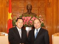 Phó Thủ tướng Nguyễn Xuân Phúc tiếp Đại diện TTX Lào