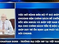 Việt Nam điều chỉnh tỷ giá là bước đi tích cực