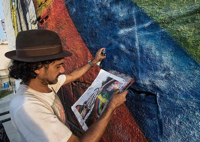 Nghệ sĩ lập kỷ lục vẽ tranh tường ăn mừng thế vận hội Olympic - Ảnh 3.