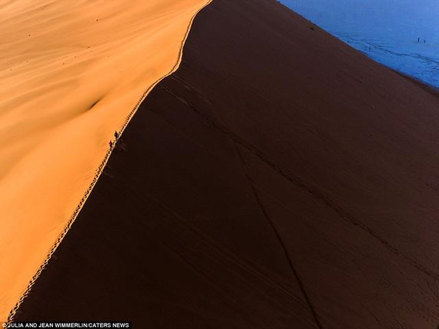 Khó tin với vẻ đẹp bất tận của cồn cát ở Namibia - Ảnh 4.