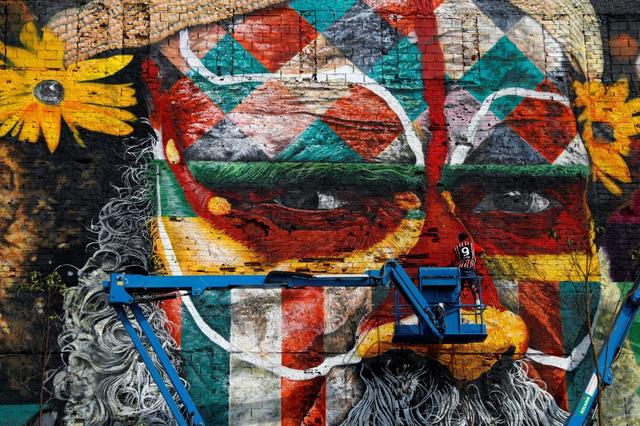 Nghệ sĩ lập kỷ lục vẽ tranh tường ăn mừng thế vận hội Olympic - Ảnh 7.