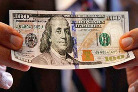 4 dấu hiệu nhận biết tiền USD giả - Ảnh 1.