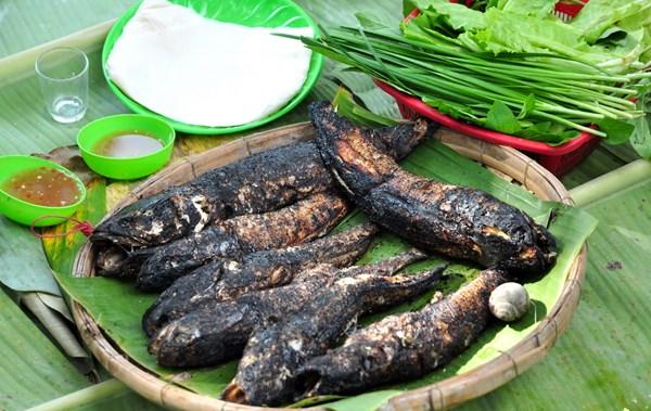 Cá lóc nướng trui - món ăn dân dã của người miền Tây - Ảnh 1.