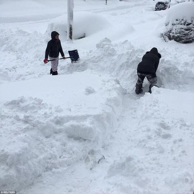 Mỹ lạnh kỷ lục, nước sôi hắt ra hóa tuyết tức khắc - Ảnh 8.