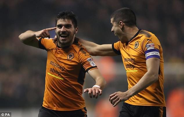 Bất chiến tự nhiên thành, Wolves có vé thăng hạng đầu tiên - Ảnh 1.