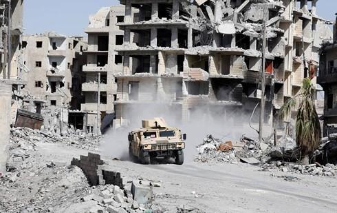 Những chuyến hàng cứu trợ đầu tiên của LHQ tới Raqqa sau 4 năm - Ảnh 1.