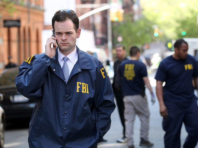 FBI vẫn bắt buộc thuê hacker để mở khóa điện thoại - Ảnh 1.