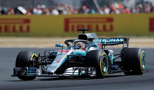Hamilton giành pole trên sân nhà tại Anh, bộ đôi Ferrari ngay đằng sau - Ảnh 1.