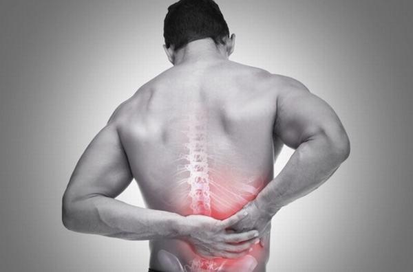 Bệnh đau lưng tấn công người trẻ - Ảnh 2.