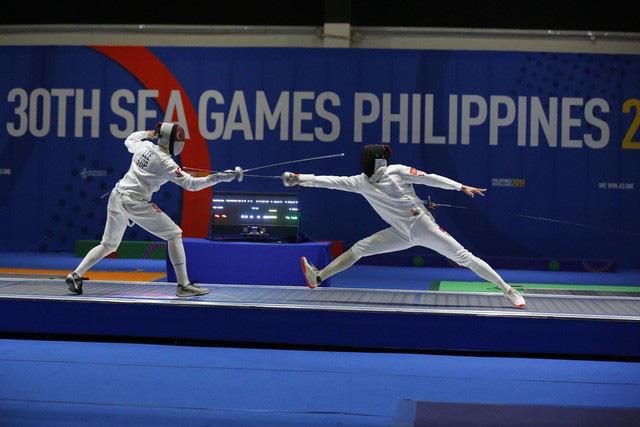 Khoảnh khắc ấn tượng trong ngày thi đấu 8/12 tại SEA Games 30: Ngày vàng của thể thao Việt Nam - Ảnh 4.