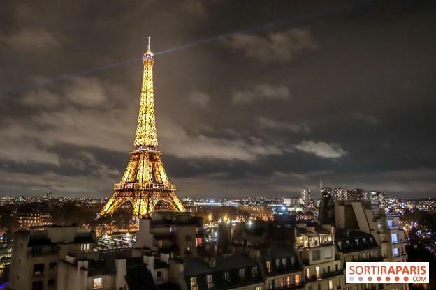Tháp Eiffel thắp đèn mừng 130 năm tuổi - Ảnh 3.