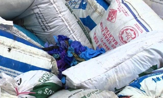 Phát hiện hơn 13 triệu găng tay cao su nhập khẩu đã qua sử dụng - Ảnh 1.