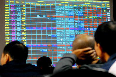 Thị trường chứng khoán xanh vỏ, đỏ lòng - Ảnh 1.