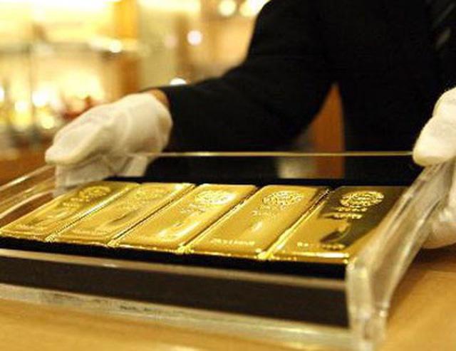 Giá vàng giao dịch ở mức 56,27 triệu đồng/lượng - Ảnh 1.