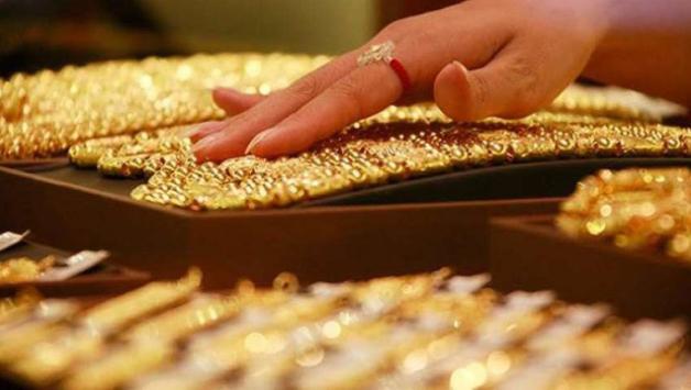 Giá vàng lao dốc trước sự mạnh lên của đồng USD - Ảnh 1.