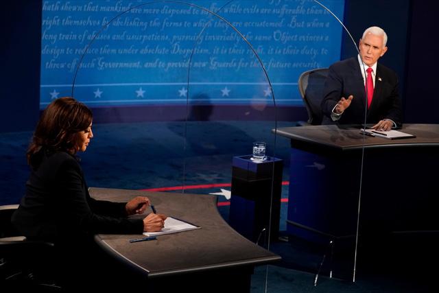 Hai ứng cử viên Phó Tổng thống Mỹ bước vào cuộc tranh luận trực tiếp duy nhất - Ảnh 2.