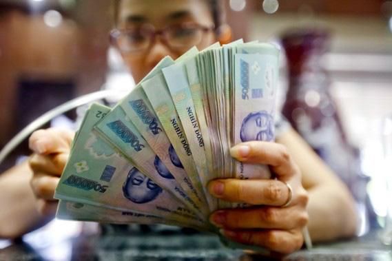 VNDirect: Tiền đồng có thể mạnh lên trong năm 2021 - Ảnh 1.