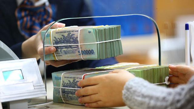 Tiền gửi của các ngân hàng thương mại tăng hơn so với rút ra - Ảnh 1.