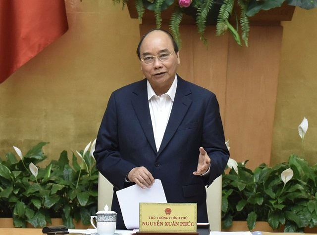Prime Minister Nguyen Xuan Phuc speaks at a meeting with a number of key private economic groups, Hanoi, March 12, 2020. (Photo: NDO/Tran Hai)