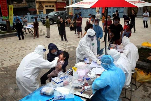 Hà Nội điều động 15 đội phản ứng nhanh về Mê Linh dập ổ dịch COVID-19 thôn Hạ Lôi - Ảnh 1.