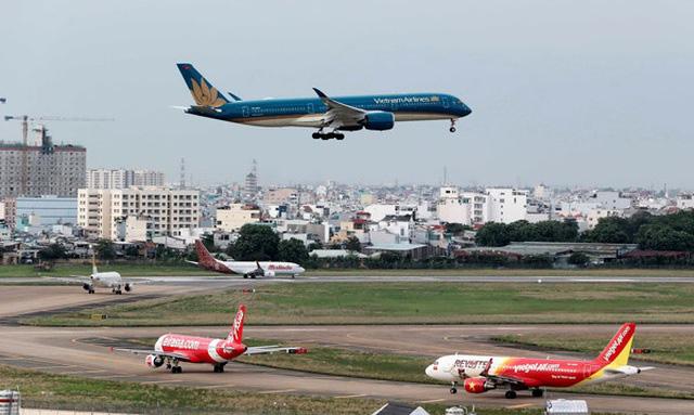 Giãn lượt cất, hạ cánh tại sân bay Nội Bài và Tân Sơn Nhất từ ngày mai (16/7) - Ảnh 1.