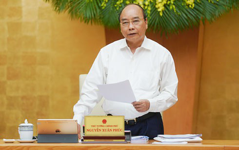 Prime Minister Nguyen Xuan Phuc says the economic growth must not be lower than the 2.7% forecst by the IMF (Photo:VGP)