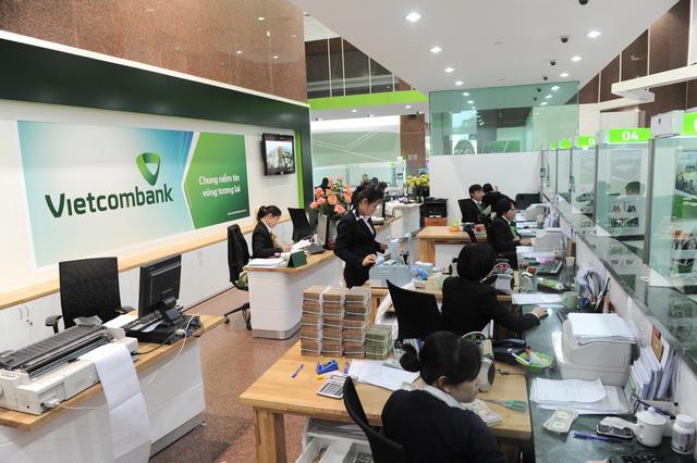 Một loạt ngân hàng tiếp tục giảm lãi suất huy động - Ảnh 1.