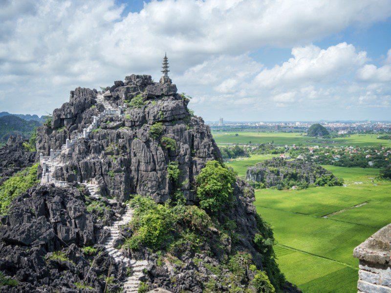 Top pagoda of Hang Mua temple, rice fields, Ninh Binh Vietnam. (Photo: TripstoDiscover)