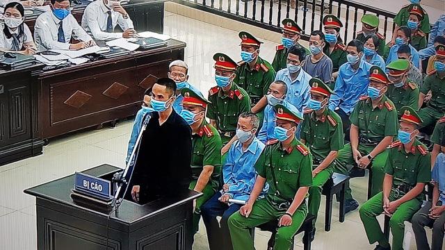 Đang xét xử vụ án giết người, chống người thi hành công vụ ở xã Đồng Tâm - Ảnh 1.