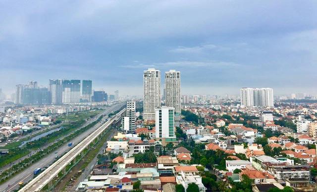 Thị trường địa ốc gặp khó, có nên mua bất động sản lúc này? - Ảnh 1.