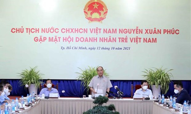 President Nguyen Xuan Phuc addresses the meeting in HCM City on October 12. (Photo: VNA)