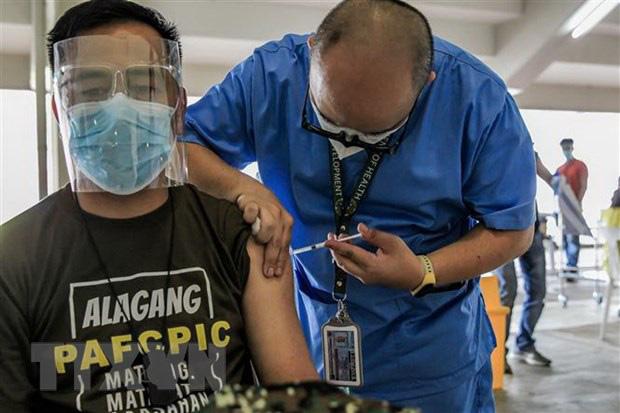 Hơn 115 triệu ca nhiễm COVID-19 trên thế giới, Nhật Bản cân nhắc gia hạn tình trạng khẩn cấp - Ảnh 1.