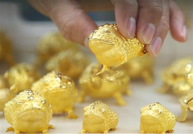 Giá vàng thế giới suy giảm tuần thứ 3 liên tiếp - Ảnh 1.