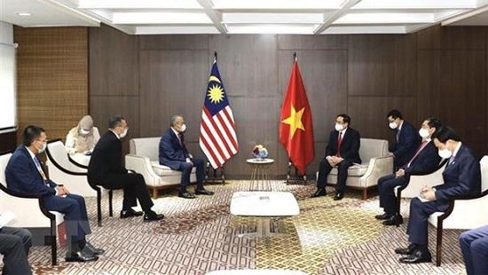 PM Pham Minh Chinh meets Malaysian PM Muhyiddin Yassin (Photo: VNA)