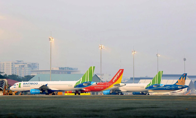 Cục Hàng không đề xuất bỏ giá trần vé máy bay - Ảnh 1.