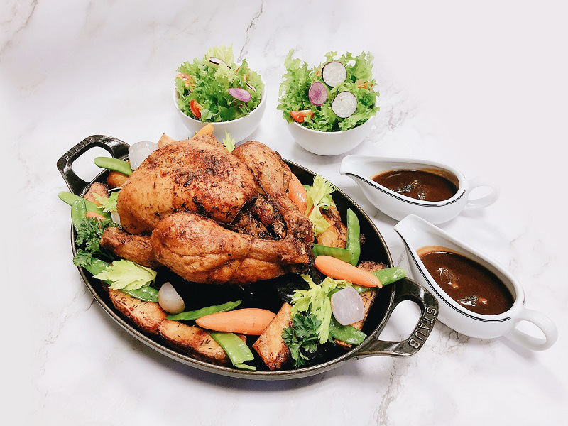 The dish of Whole French Roasted Chicken with Himalayan Salt and Phu Quoc Pepper is prepared by Hotel Metropole Hanoi.  Photo courtesy of the hotel