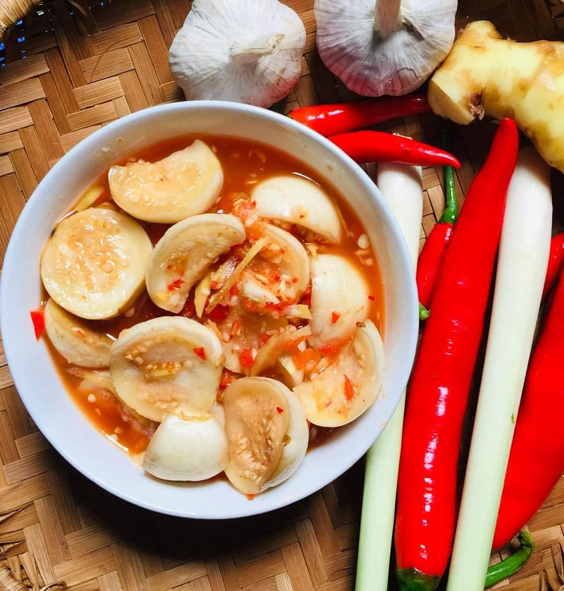 A dish of sweet and sour pickled eggplant with chili and ginger. Photo: Van Lai
