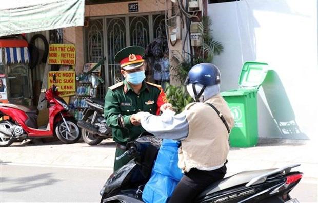 TP Hồ Chí Minh ngày đầu thực hiện quy định không ra đường sau 18h00 - Ảnh 1.