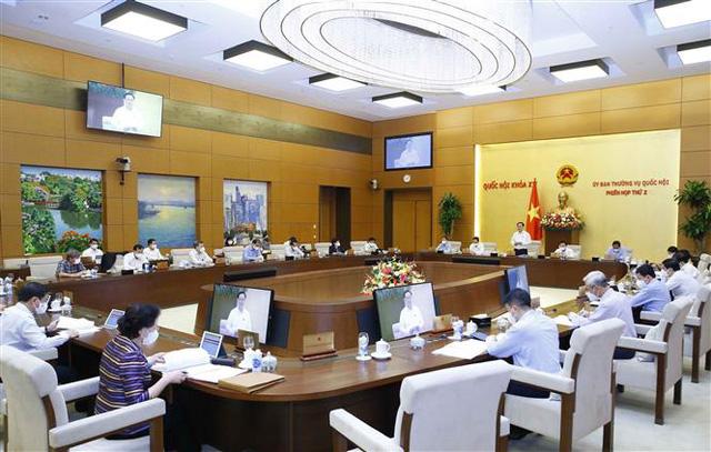 Phiên họp thứ 3 của Ủy ban Thường vụ Quốc hội xem xét miễn giảm thuế cho người dân khó khăn vì COVID-19 - ảnh 1